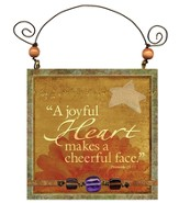 A Joyful Heart Makes a Cheerful Face Plaque