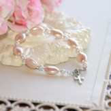 Oval Glass Pearls And Crystals Cross Bracelet, Pink