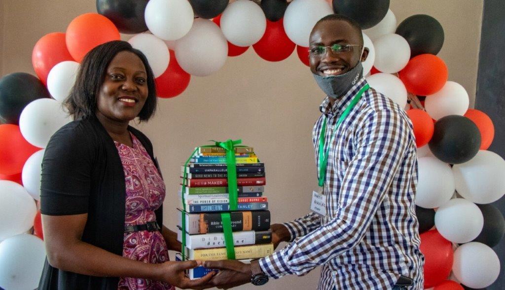 Bible college students in Uganda receiving personal libraries upon graduation