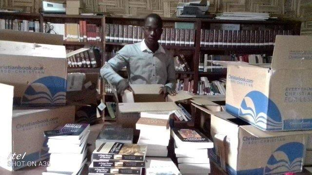 Textbooks arriving at a seminary in Liberia