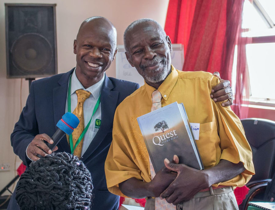 Pastor in Uganda receiving his first study Bible after 40 years in ministry